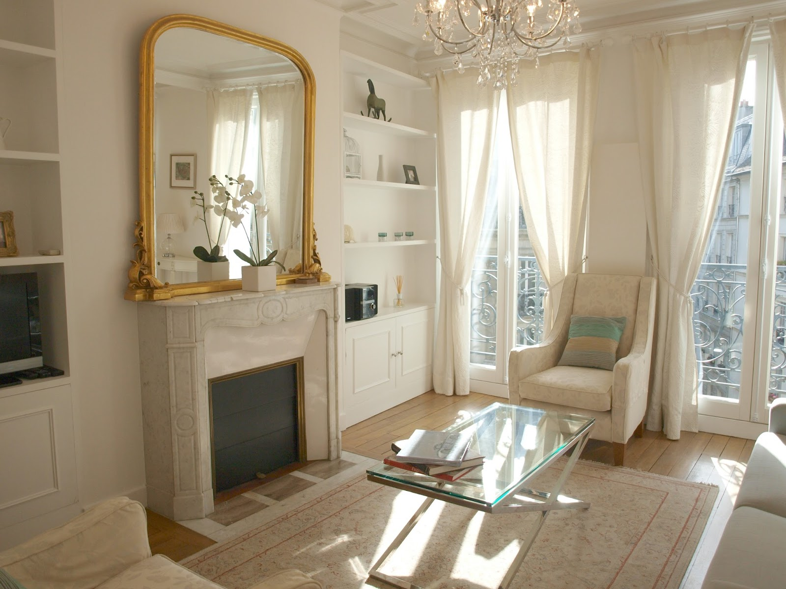 Gorgeous white Paris apartment decor with chandelier and balcony - by Hello Lovely Studio
