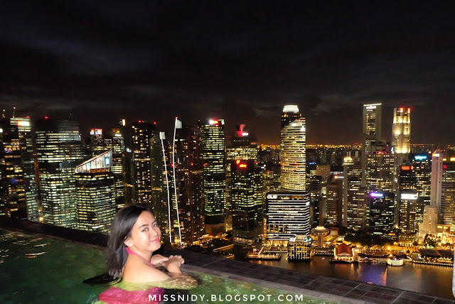 infinity pool marina bay sands hotel at night