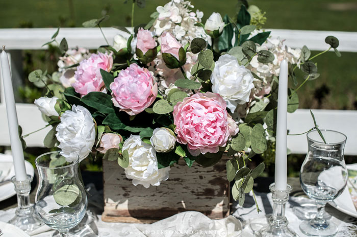 Centerpiece made of pink and white artificial peonies