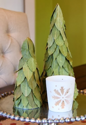 http://www.makeit-loveit.com/2012/12/simple-christmas-decor-burlap-table-runner-bay-leaf-trees.html