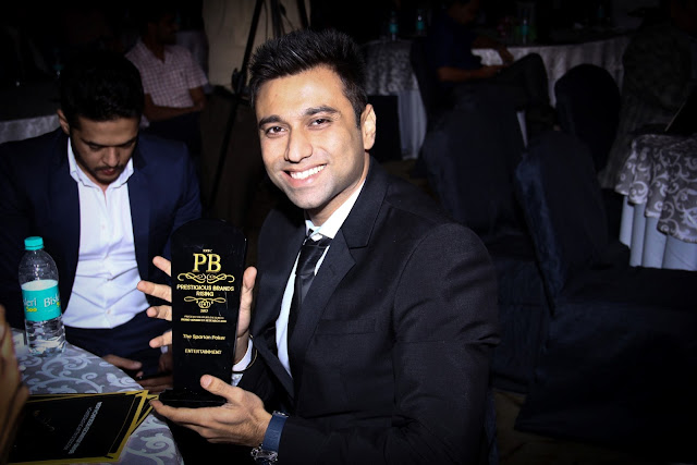 Amin Rozani Director TheSpartanPoker with ERTC's Prestigious Brand Award