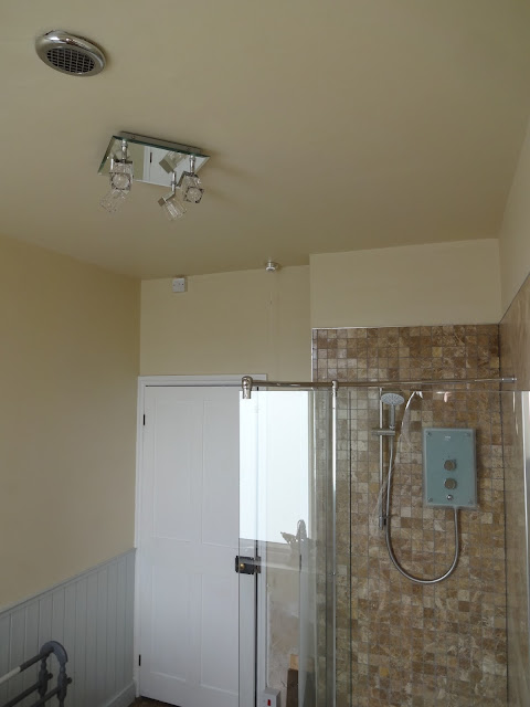 locating the extractor fan in a bathroom