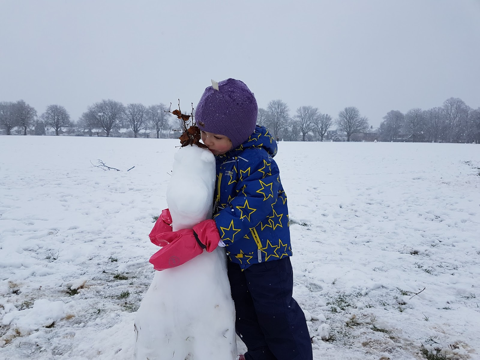 hugging the snow pony