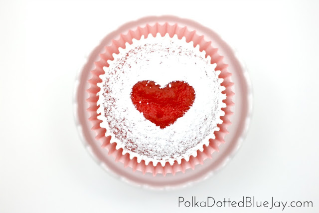How to make powdered sugar heart cupcakes! Click through to see how to make bright red cupcakes with a beautiful heart - perfect for Valentine's Day or as a sweet treat for your sweetheart!