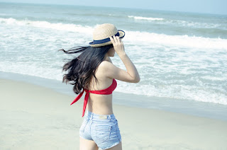woman with hat at the beach.jpeg