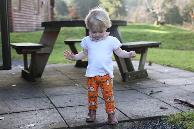 colourful and unique clothing for your toddler from me&i - she wears harry & lily playing leggings-orange Indian pattern leggings with brown ankle boots