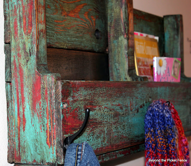 use a pallet to make a storage piece for the entryway