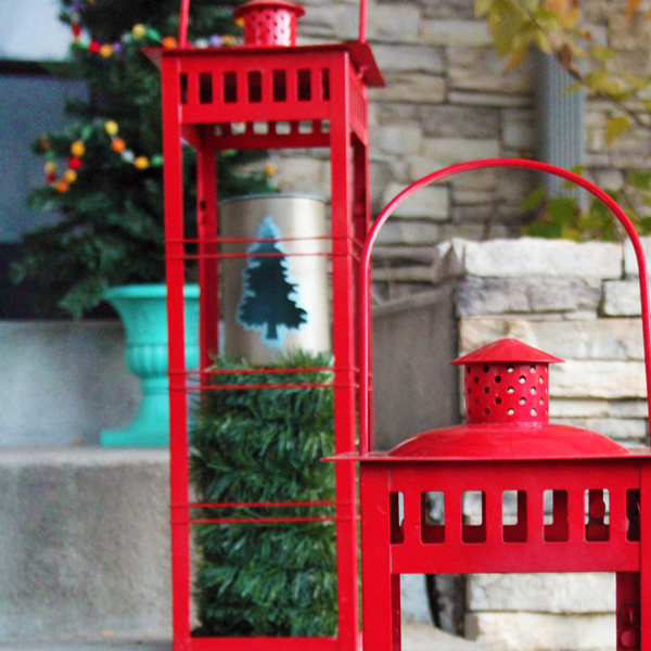 Candle lanterns on front porch for Christmas