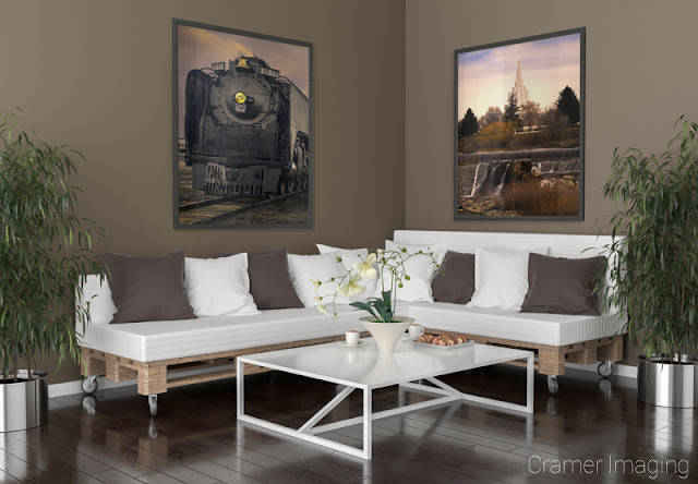 Photograph of Cramer Imaging's fine art photographs 'Union Pacific 844 Steam Engine' and 'Idaho Falls Temple' on the wall of a living room setting