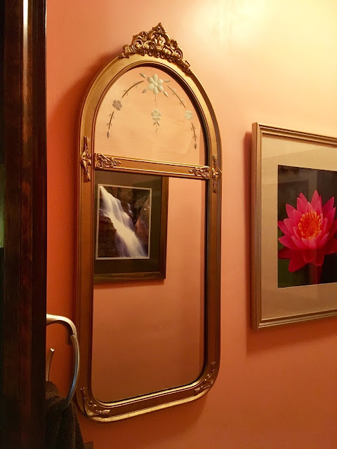 image of an antique bathroom mirror in a bathroom with 'sun kissed apricot' painted walls