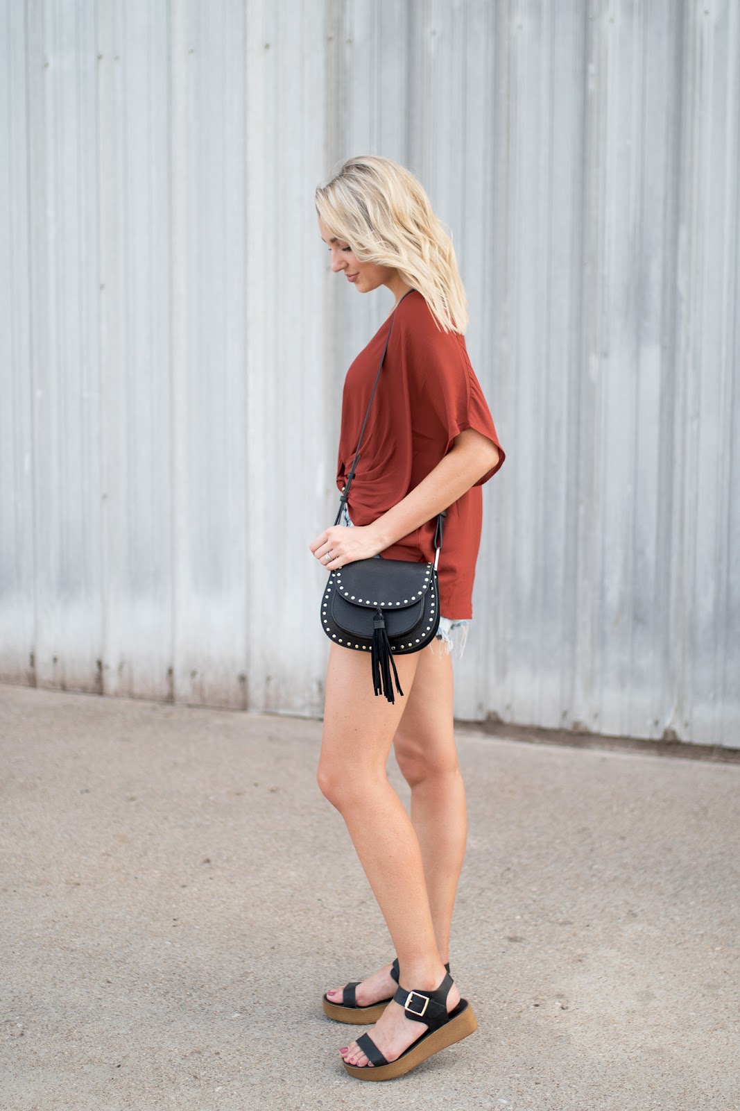 Draped blouse with cutoffs and platform sandals