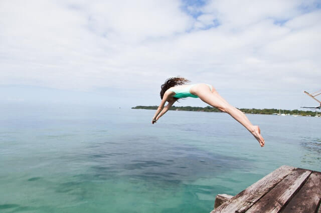 Photo-of-Woman-Diving-Into-the-Water