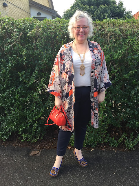 My new uniform of jersey trousers, t-shirt and kimono. Here with heels