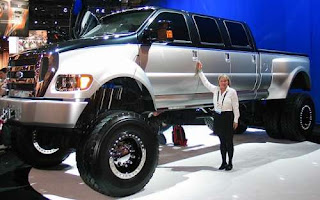 Oh, my, that's one cartoonishly large pick up truck! So, what's the guy making up for?