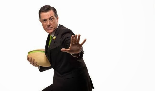 Stephen Colbert works with Pistachios at the Superbowl.