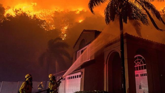 Firefighters battling massive powerful wildfire in California suburbs