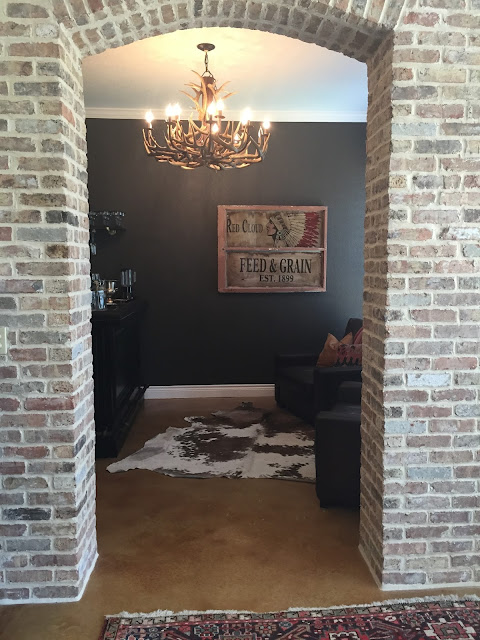 antler chandelier, black wall paint , pottery barn bar, bar ideas, man cave, interior brick wall