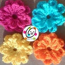 http://translate.googleusercontent.com/translate_c?depth=1&hl=es&rurl=translate.google.es&sl=en&tl=es&u=http://snappy-tots.com/free/free-button-flower-crochet-pattern/&usg=ALkJrhjdLRC1nt8W5mPzZNIJdVFdYGVOVQ