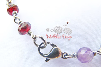 Close up of Wire wrapped Minima Bracelet (Minlet) with Garnet, Swarovski Crystal & Amethyst
