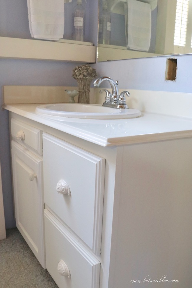 Budget wise cultured marble countertop with ogee edges and a porcelain sink offers a vanity with style