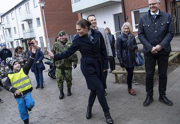 Crown Princess Victoria of Sweden visited Helsingborg Municipality and Vera industrial Park. She wore blue wool coat