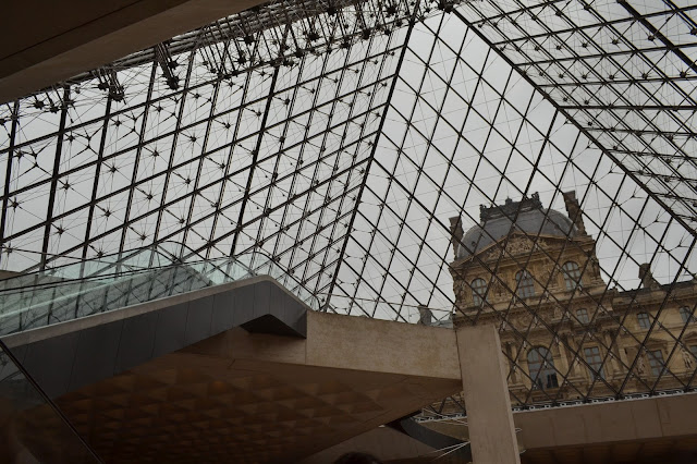 The inside of the glass pyramid at the Louvre, Paris