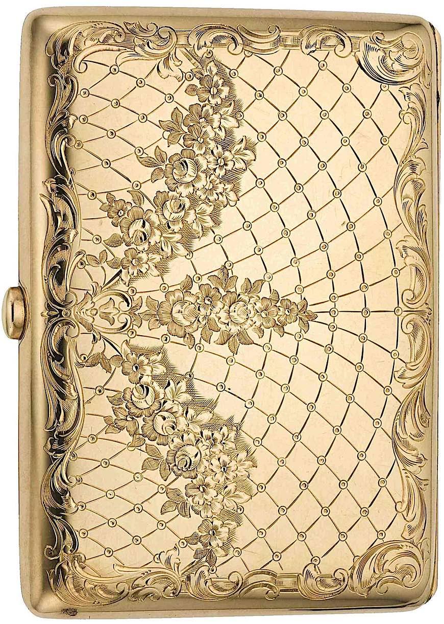 an 1890s? gold cigarette case, color photograph