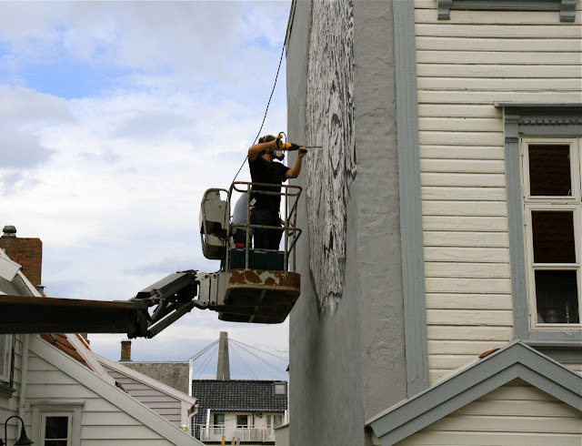 street artist vhils at work for nuart 2013 2