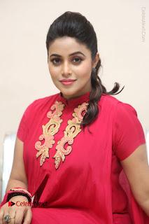 Actress Poorna Latest Stills in Red Dress at Rakshasi First Look Launch  0276.JPG