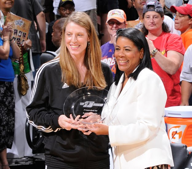 dd11eca8ab33d (7.23.2011 - Katie Smith receives her Top 15 WNBA award from league  President Laurel Richie - San Antonio Texas - WNBA All-Star Game  -NBAE Getty Images)