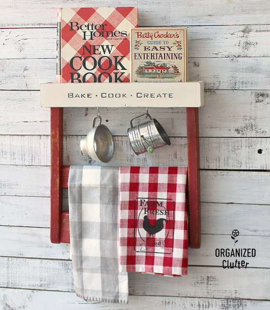 Chair Back Repurposed As Farmhouse Kitchen Decor #chairback #repurpose #repurposed #upcycle #homesteadhousemilkpaint #farmhousekitchen #farmhousestyle #cookbookdisplay #oldsignstencils