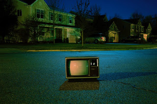 a television outside in the middle of a street