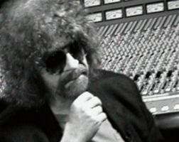 Singer, writer and producer, Jeff Lynne of ELO, the Electric Light Orchestra, sat in the recording studio, in full beard and shades mode