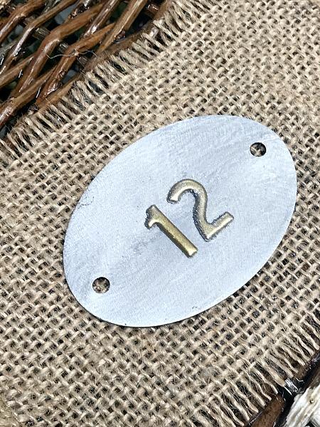 metal tag on burlap number 12