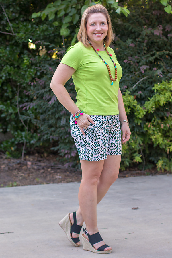 Print shorts and bright top