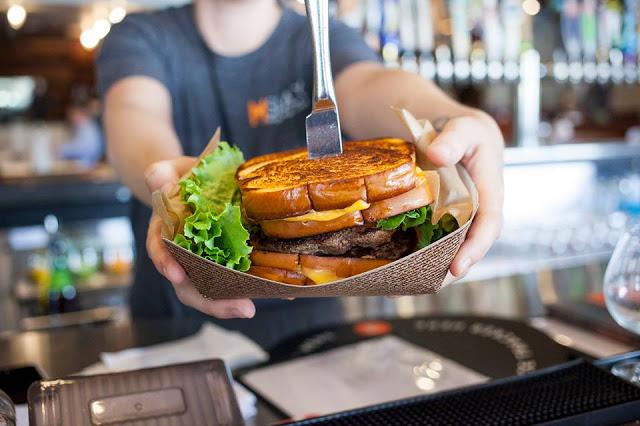 Enjoy a burger at MShack, a local favorite