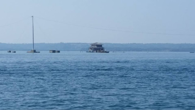 A distant view of the fish Masinloc sanctuary and the floating electric post.