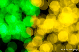 Cramer Imaging's professional quality fine art photograph of yellow and green blurry Christmas lights in Pocatello, Bannock, Idaho