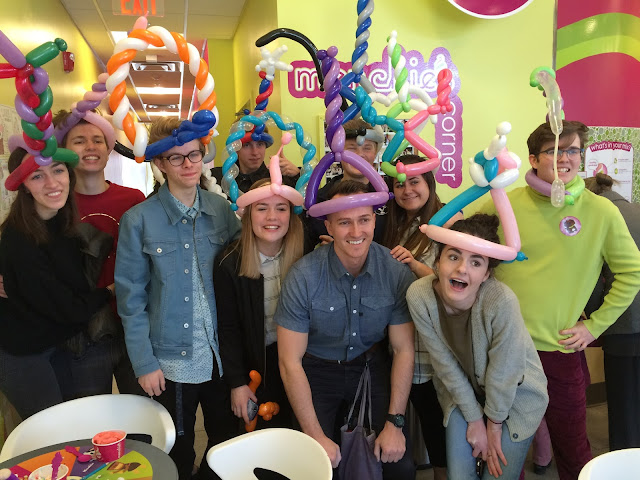 A group of teenagers displaying their crazy balloon hats at the menchies grand opening in Draper.