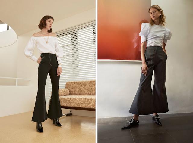Девушки в черных брюках клеш и белых блузках