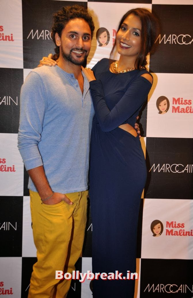Monica Dogra  The stunning Monica Dogra towers over her date in a figure-hugging evening gown at a Marc Cain event