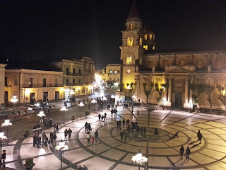 Acireale's Piazza del Duomo is illuminated at night