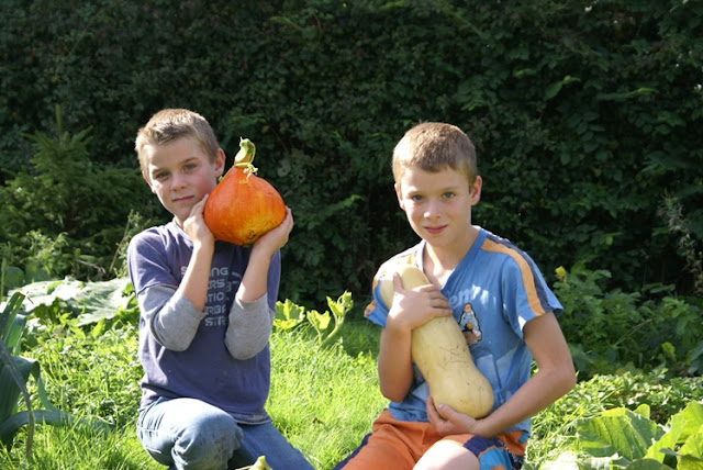 Children with their pumpkin harvest