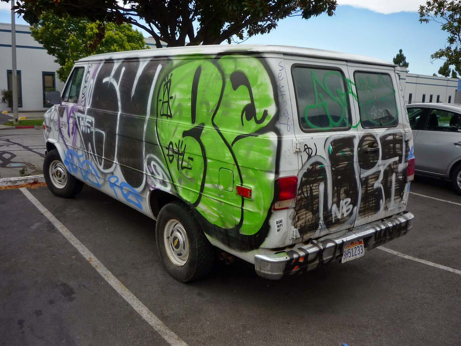 Vandalized van comprehensive auto claim before repair at Almost Everything Auto Body
