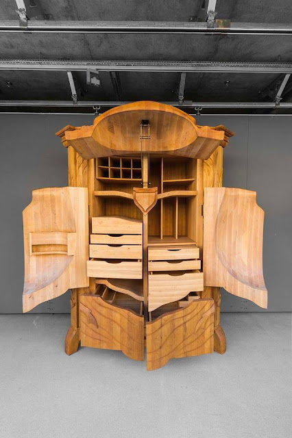 Latvian Artist Carves Wood Cabinet In Shape Of Giant Beetle