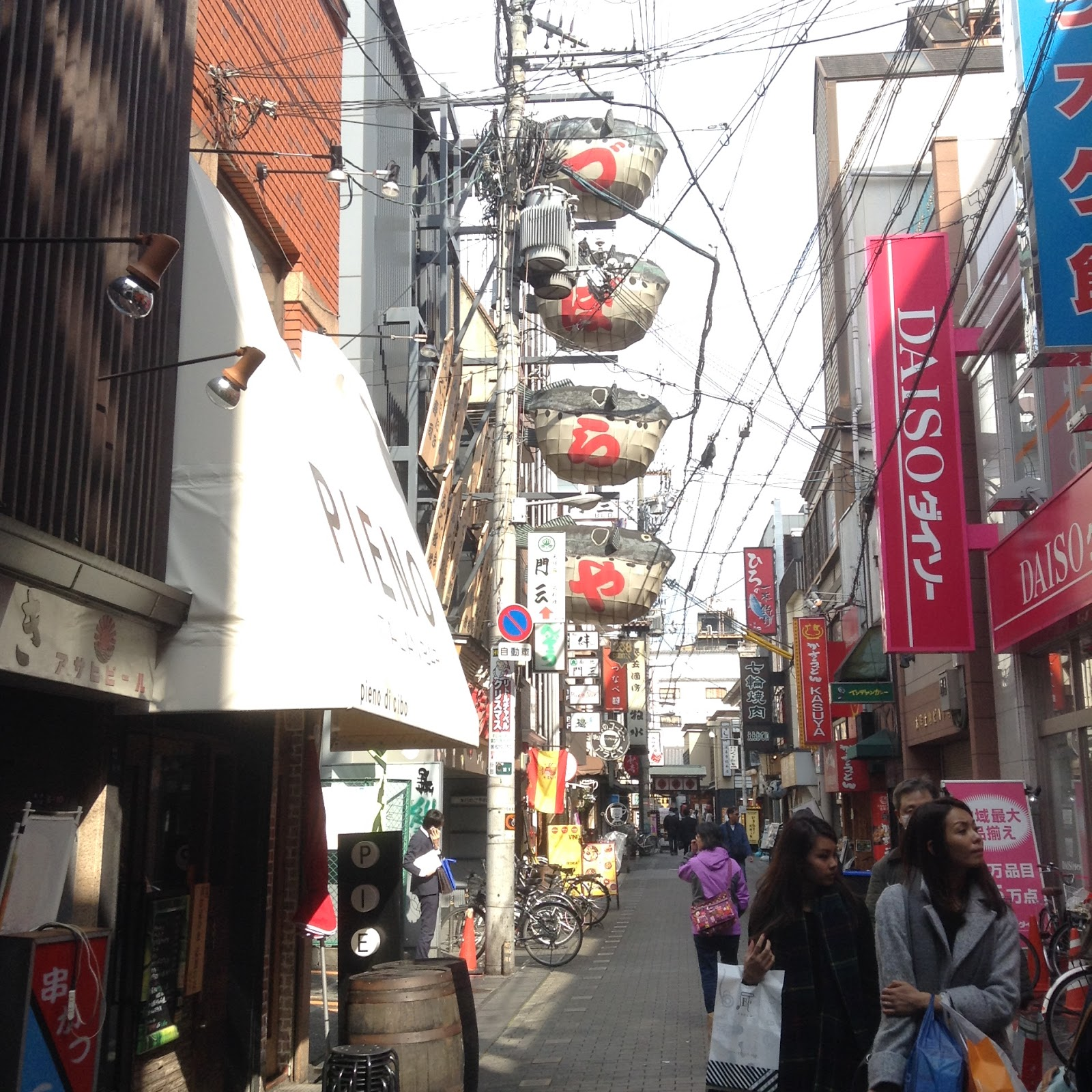 Osaka side street with Daiso and fugu fish signs