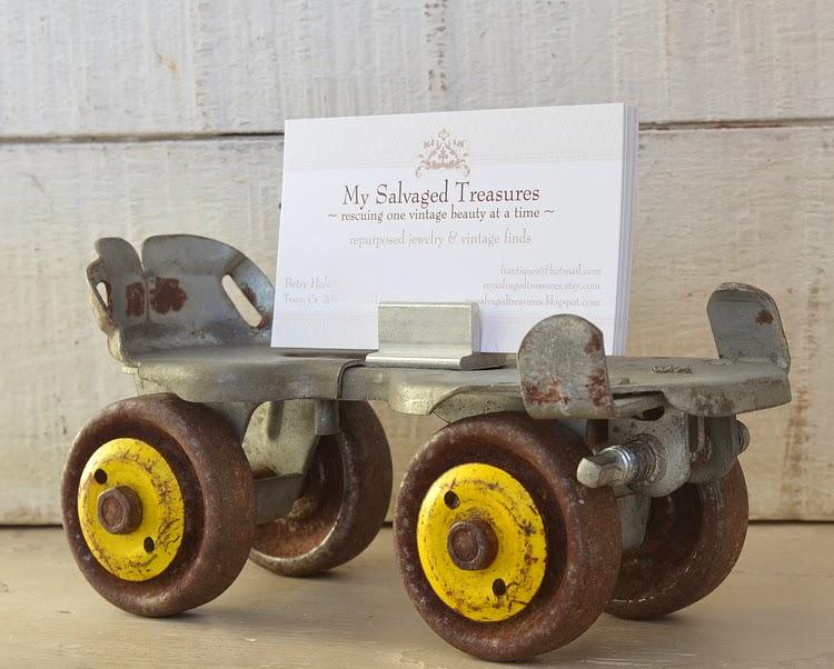 Repurposed rusty old roller skate card holder.