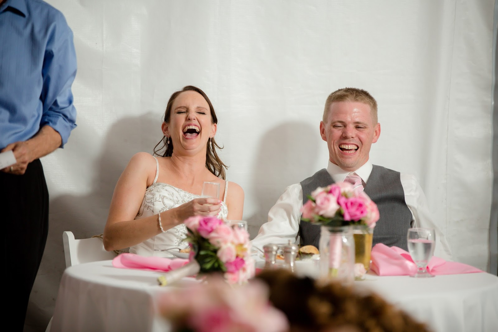 bride laughing over speeches