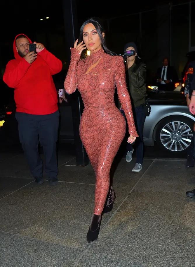 Kim Kardashian West heads out in a snakeskin skin-tight dress