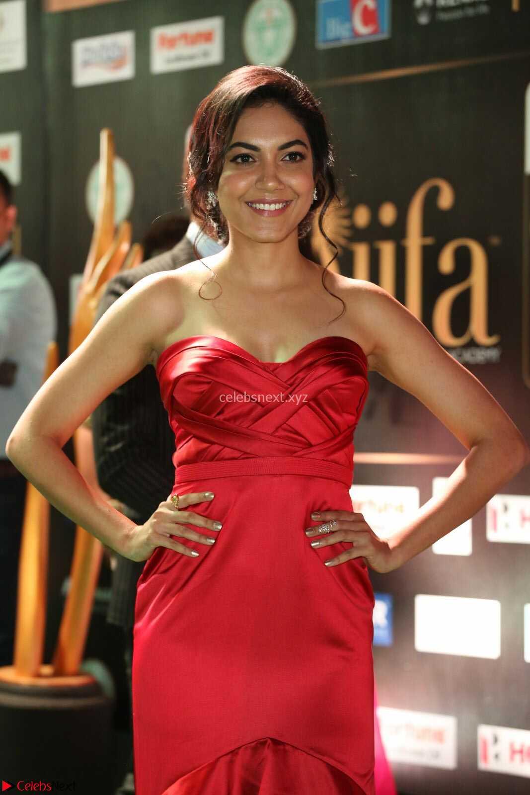 Reetu Varma smiling beauty in Deep Neck Red Gown at IIFA Utsavam Awards 2017  Day 2 CelebsNext Exclusive